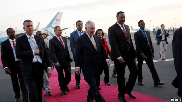 Ethiopia's Minister of Foreign Affairs Workneh Gebeyehu (center R) walks the red carpet with U.S. Secretary of State Rex Tillerson as he arrives to begin a six-day trip in Africa, landing at Addis Ababa International Airport in Addis Ababa, March 7, 2018.