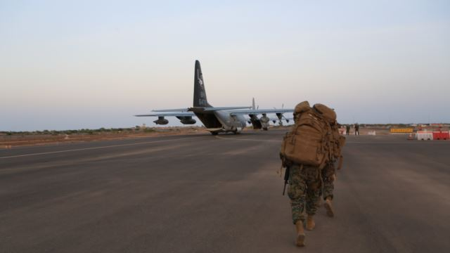 FILE - In this image released by the U.S. Department of Defense, U.S. Marines and sailors prepare to board a KC-130J Marine Super Hercules at Camp Lemonnier, Djibouti, Dec. 24, 2013.