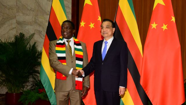FILE - Zimbabwean President Emmerson Mnangagwa shakes hands with Chinese Premier Li Keqiang before their meeting at the Great Hall of the People in Beijing, China, April 4, 2018.